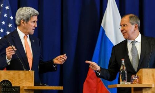 Ngoại trưởng Mỹ John Kerry (trái) và người đồng cấp Nga Sergei Lavrov. Ảnh: AFP.