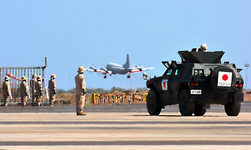 A Self-Defense Force P-3C maritime surveillance aircraft and light armored vehicle stationed at the SDF anti-piracy base in Djibouti (Yusuke Fukui)