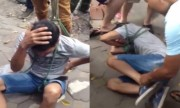 Kẻ trộm xe máy bị đám đông trói tay chân, đánh hội đồng
