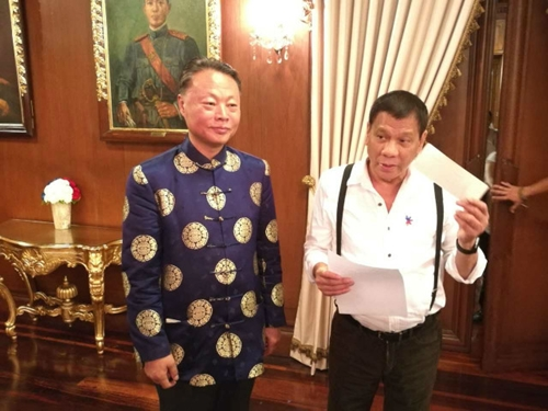 CHINESE AID. Chinese Ambassador to the Philippines Zhao Jianhua is seen with Philippine President Rodrigo Duterte in this handout photo on October 24, 2016, as China announces millions in typhoon aid for the Philippines. Photo courtesy of Chinese embassy