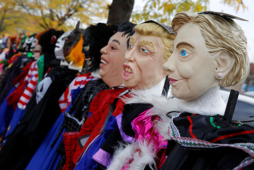 Halloween masks depicting U.S. presidential candidates Hillary Clinton and Donald Trump are seen for sale on a street corner in Chicago, Illinois, U.S., October 25, 2016.