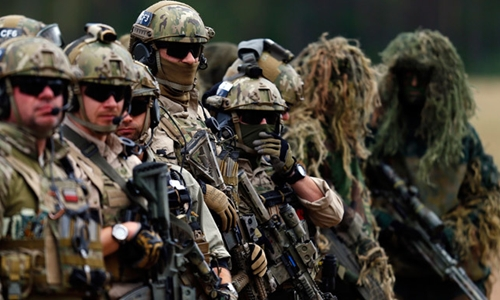 Members of Polands special commando unit Lubliniec participate in the Noble Sword-14 NATO international tactical exercise at the land forces training centre in Oleszno, near Drawsko Pomorskie, northwest Poland September 9, 2014.(Reuters / Kacper Pempel) / Reuters