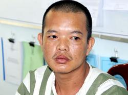 Nguyễn Quốc Trung sau khi bị bắt giữ. Ảnh: Hồng Tuyết