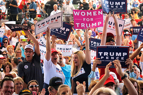[Caption]Supporters of Republican U.S. presidential nominee Donald Trump attend a rally in St. Augustine, Florida, U.S. October 24, 2016. REUTERS/Jonathan Ernst/File Photo