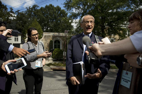 n this photo taken Oct. 5, 2016, Democratic presidential candidate Hillary Clintons campaign manager John Podesta speaks to members of the media outside Clintons home in Washington.