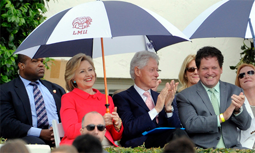 [Caption]Democratic presidential candidate Hillary Clinton with her husband and former President Bill Clinton along with Roger Clinton Jr., right, whos son Tyler Clinton graduated during the Loyola Marymount 2016 Commencement on the campus of Loyola Marymount University on Saturday, May 7, 2016 in Los Angeles. Authorities say Roger Clinton, younger half-brother of former President Clinton, has been arrested Sunday, June 5, 2016, on suspicion of drunken driving in the seaside city of Redondo Beach, Calif. (Photo by Libby Cline)