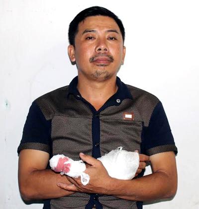 Nghi can Nguyễn Ngọc Châu tại cơ quan công an. Ảnh: Hồ Nam