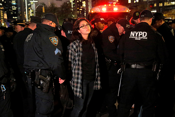 A woman is detained during aprotestoutside theTrumpInternational Hotel and Tower following President-elect DonaldTrump's election victory in Manhattan, New York, U.S., November 9, 2016. REUTERS/Andrew Kelly