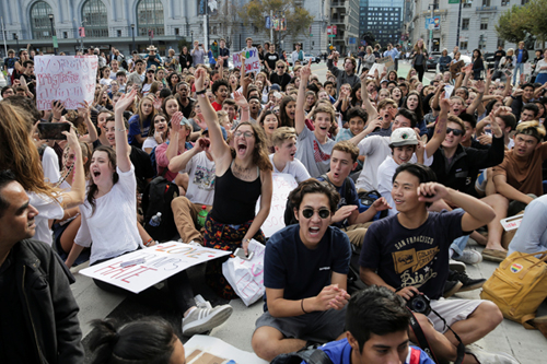 Students hold a sit-in in front of City Hall protesting the election of Republican DonaldTrump as President of the United States in San Francisco, California, U.S. November 10, 2016. REUTERS/Elijah Nouvelage