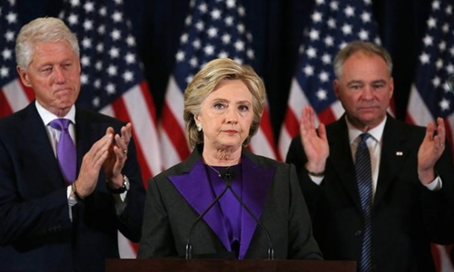 Hillary Clinton, accompanied by her husband former U.S. President Bill Clinton (L) and running mate Senator Tim Kaine, addresses her staff and supporters about the results of the U.S. election at a hotel in New York, November 9, 2016. REUTERS/Carlos Barria