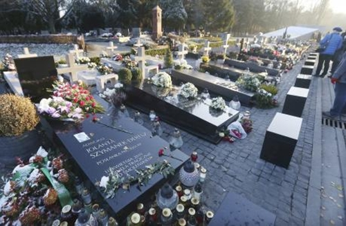 In this picture taken Saturday Nov. 12, 2016 the grave stones of some of the victims of the 2010 plane crash in Russia that killed Polands President Lech Kaczynski and 95 other prominent Poles, at the Powazki Cemetery, in Warsaw, Poland. The bodies of Kaczynski and his wife Maria Kaczynska are being exhumed after dark on Monday, Nov. 14, 2016 for examination on orders from the prosecutors, who are investigating the crash. Also remains of 81 other victims will be exhumed because findings from autopsies carried out in Russia are flawed and unreliable, prosecutors say. (AP Photo/Czarek Sokolowski)
