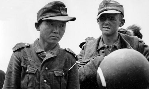Yang Kyoungjong ( bên trái) được cho là người lính đen đủi nhất thế chiến II khi tham chiến trong màu áo của ba quân đội ở cả hai phe. Ảnh: History.