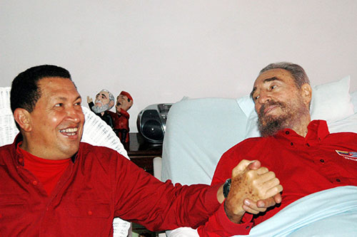 [Caption]Venezuelan President Hugo Chavez (L) visits his then Cuban counterpart Fidel Castro in Havana in this August 13, 2006 file photo. REUTERS/Estudios Revolucion-Granma/Handout/File Photo ATTEN