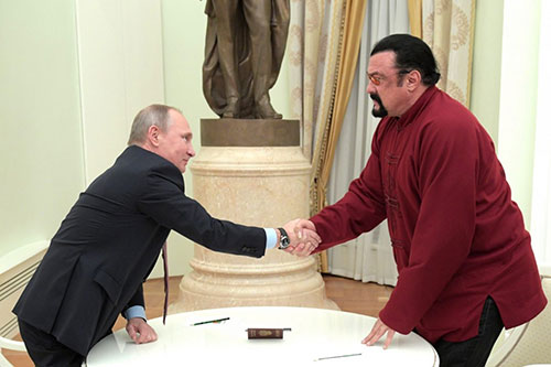 Russian President Vladimir Putin shakes hands with Steven Seagal at the Kremlin in Moscowon Nov. 25. (Alexei Druzhinin/Sputnik, Kremlin via AP)