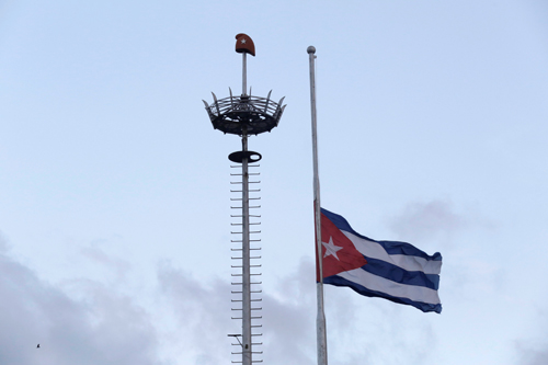 [Caption]The Cuban flag flies at half mast after the death of Cubas former President Fidel Castro was announced at Revolution Square in Havana, Cuba November 26, 2016. REUTERS/Enrique De La Osa TPX IMAGES OF THE DAY