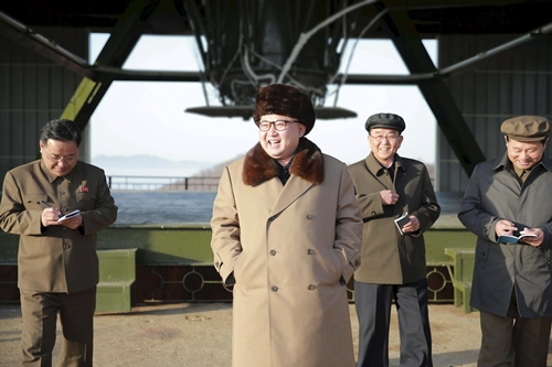 orth Korea leader Kim Jong Un smiles as he visits Sohae Space Center for the testing of a new engine for an ICBM