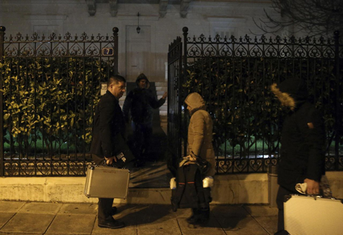 Police investigators enter the house of the Russian consul Andrei Malanin in Athens, Monday, Jan. 9, 2017. Greek police say the Russian consul in Athens has been found dead in his flat in the Greek capital, but there are no immediate indications of foul play.(Costas Baltas/InTime News via AP)