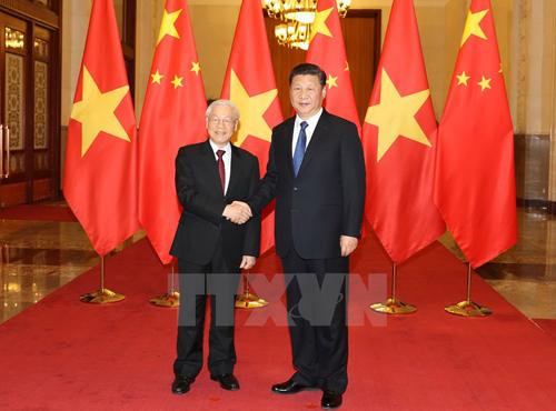 Chủ tịch Trung Quốc Tập Cận Bình đón Tổng Bí thư Nguyễn Phú Trọng. Ảnh: TTXVN