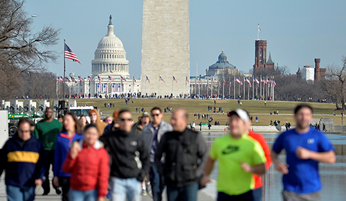 Tourists and visitors crowd the Reflecting Pool and the Washington Monument (C) with the U.S. Capitol in the background, in the days prior to Donald J. Trumps inauguration, in Washington, U.S., January 15, 2017. REUTERS/Mike Theiler