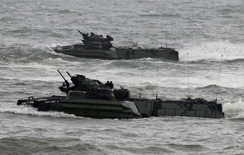 [Caption]US military forces aboard Amphibious Assault Vehicles (AAV) maneuver on the South China Sea during the annual Philippines-US amphibious landing exercise (PHIBLEX) in San Antonio, Zambales province, Philippines, October 7, 2016. Reuters/Romeo Ranoco