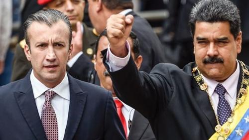 Ông Tareck el-Aissami (trái) và Tổng thống Nicolas Maduro. Ảnh: AFP