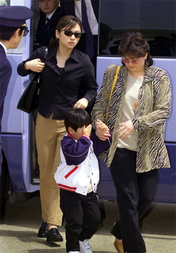 Two women and a boy, accompanying a man believed to be Kim Jong-nam, the eldest son of North Korean leader Kim Jong Il, in 2001. Photo: AP Pho