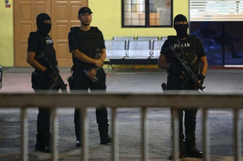 Members of the Royal Malaysia Police special operation forces standing guard at the gate of the morgue at Kuala Lumpur General Hospital where Kim Jong Nams body is held for autopsy in Malaysia, on Feb 21, 2017. PHOTO: REUTERS