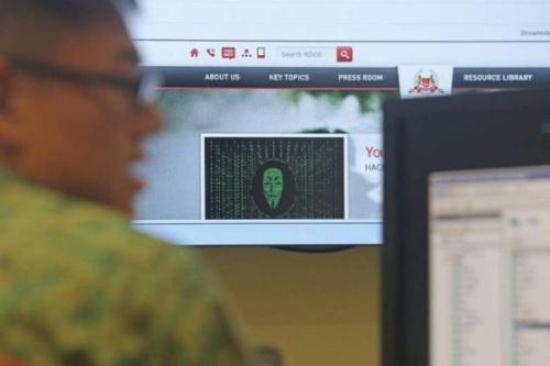 Singapore đang truy tìm thủ phạm tấn công mạng. Ảnh: StraitsTimes