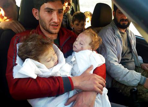 [Cap SAbdul-Hamid Alyousef, 29, holds his twin babies who were killed during a suspected chemical weapons attack, in Khan Sheikhoun in the northern province of Idlib, Syria. Alyousef also lost his wife, two brothers, nephews and many other family members in the attack that claimed scores of his relatives.