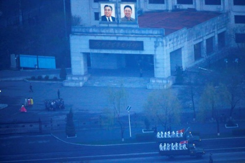 Military trucks carry soldiers through central Pyongyang before sunset as the capital preparers for a parade marking todays 105th anniversary of the birth of Kim Il Sung, North Koreas founding father and grandfather of the current ruler, April 15, 2017. REUTERS/Damir Sagolj 1/12leftright 2/12leftright 3/12leftright 4/12leftright 5/12leftright 6/12leftright 7/12leftright 8/12leftright 9/12leftright 10/12leftright 11/12leftright 12/12leftright 1/12