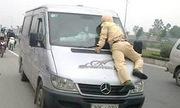 Cảnh sát giao thông có nên đu gương ôtô, nhảy lên nắp capô?