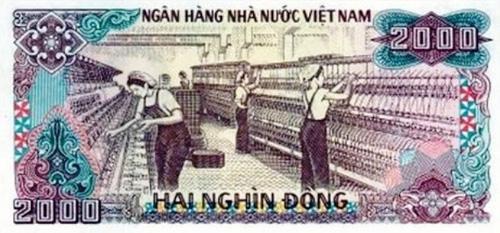 chinh-xac-thap-pho-minh-va-nha-may-det-nam-dinh-duoc-in-tren-to-tien-100-dong-va-2000-dong-1