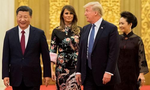 Tổng thống Mỹ Donald Trump và Phu nhân Melania cùng Chủ tịch Tập Cận Bình và bà Bành Lệ Viện đến quốc yến. Ảnh: AFP.