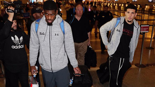 UCLA basketball players Cody Riley, left and LiAngelo Ball arrive back in Los Angeles from China fter being confined to their Hangzhou hotel for a week on suspicion of shoplifting.