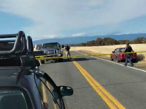 Cars are blocked on the road in northern California where several shootings have taken place, Nov. 14, 2017.