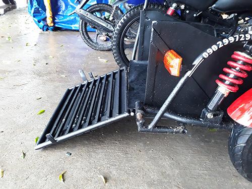 Bản độ phát triển cho người khuyết tật với thùng hàng để chở xe lăn.