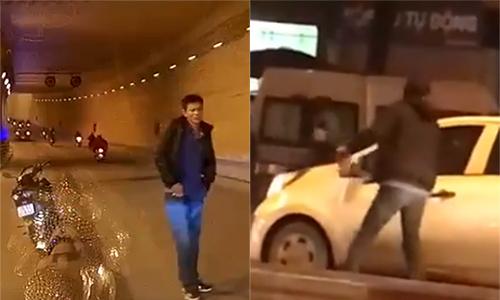 Người đàn ông cầm gạch đập kính ôtô trên phố Hà Nội
