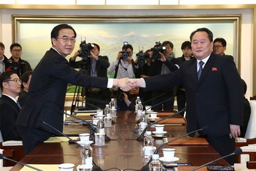 Looking businesslike, the Souths Unification minister Cho  Myoung-Gyon and the Norths chief delegate Ri Son-Gwon shook hands at the entrance to the building, and again across the table.