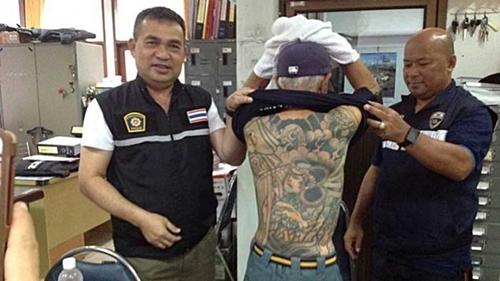 Hình xăm trên lưng Shirai. Ảnh: AFP.