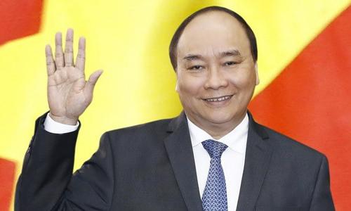 Thủ tướng Nguyễn Xuân Phúc nhắn nhủ đội tuyển U23 Việt Nam bình tĩnh, tự tin, thi đấu hết mình. Ảnh: TTXVN