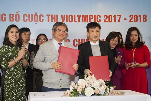 Đại diện Tập đoàn FPT và ViệnKhoa học và Giáo dục Việt Nam ký kết hợp tác chiến lược. Ảnh: Ngọc Thắng
