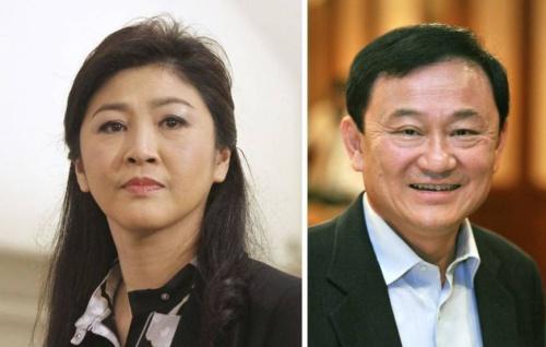 Cựu thủ tướng Yingluck Shinawatra và anh trai Thaksin. Ảnh: AFP.