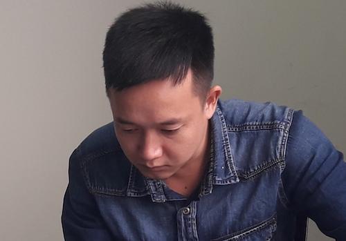 Nguyễn Công Hùng tại cơ quan công an. Ảnh: Phan Giang.