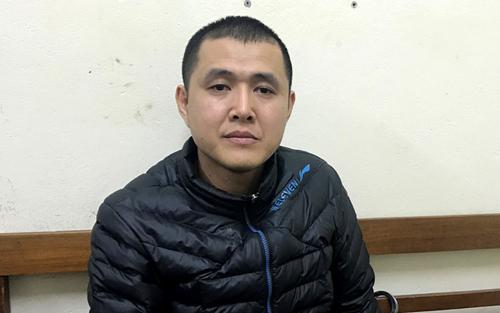 Nguyễn Thành Quang tại cơ quan điều tra. Ảnh: Công an cung cấp.