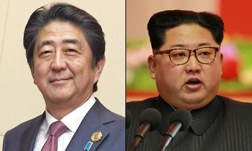 Thủ tướng Nhật Bản Shinzo Abe (trái) và nhà lãnh đạo Triều Tiên Kim Jong-un. Ảnh: Japan Times/Reuté.