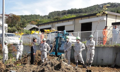 A heap of waste and soil collected during a decontamination program is piled up in the garden of a house in the Onami district in the city of Fukushima on Oct. 18, the day the city kicked off a cleanup drive that will last two years. | KAZUAKI NAGATA