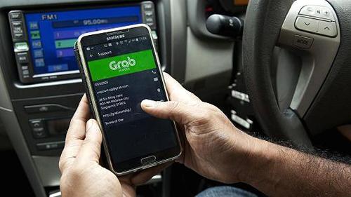Nhiều người lo ngại Grab có thể độc quyền khi không còn đối thủ trực tiếp Uber. Ảnh:CNBC.