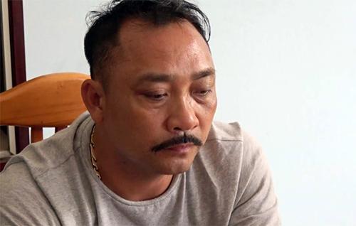 Ông trùmgỗ lậuPhan Hữu Phương tại cơ quan điều tra. Ảnh:CAND