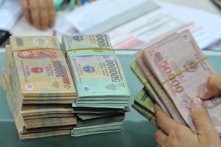 Chính phủ đề xuấtchế độ tiền lương mới cho khu vực công sẽ được thực hiện từ năm 2021. Ảnh: PV