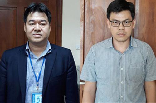 Ông Giang và Quang vừa bị bắt giữ.